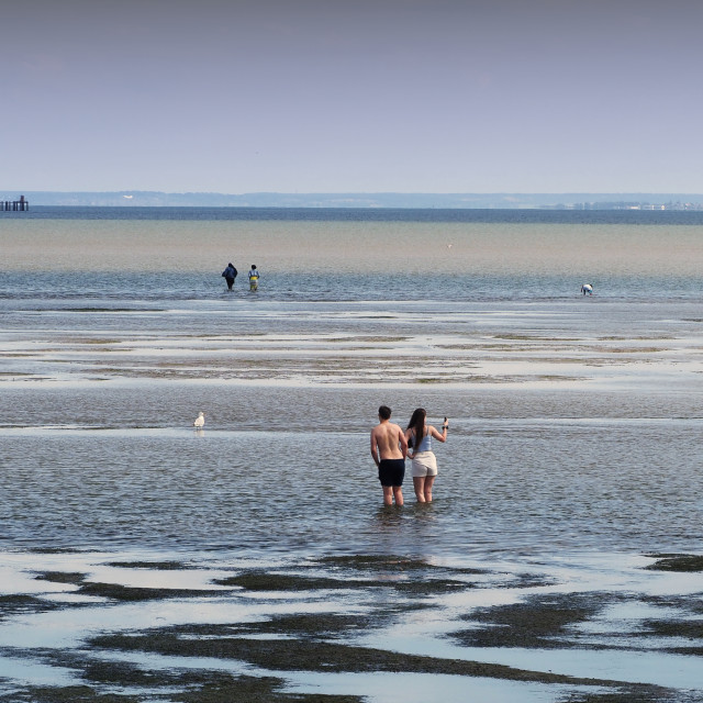 """Paddling at the seaside"" stock image"
