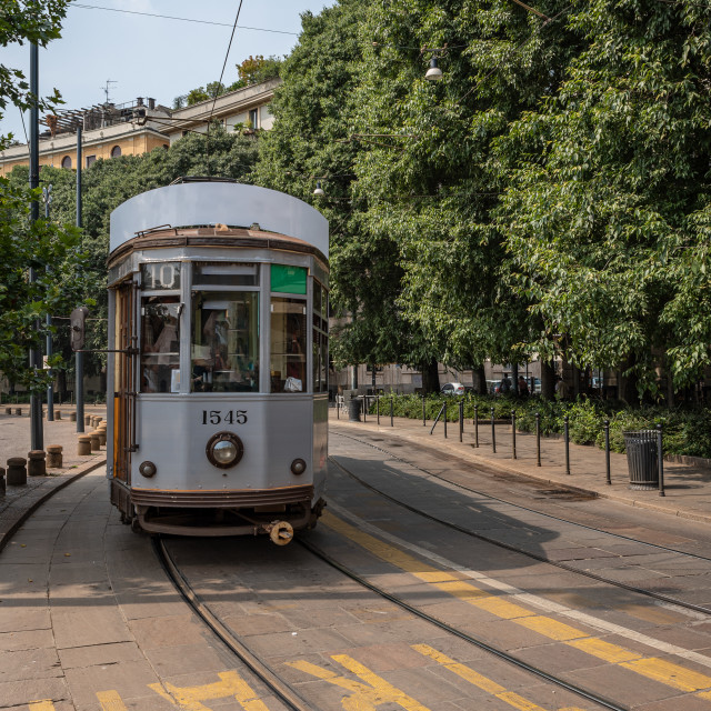 """""""A tram travels in one of the streets of an Italian city"""" stock image"""