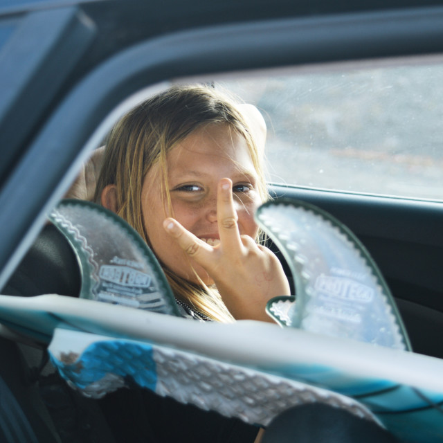 """""""Blond Surfer Boy in car"""" stock image"""
