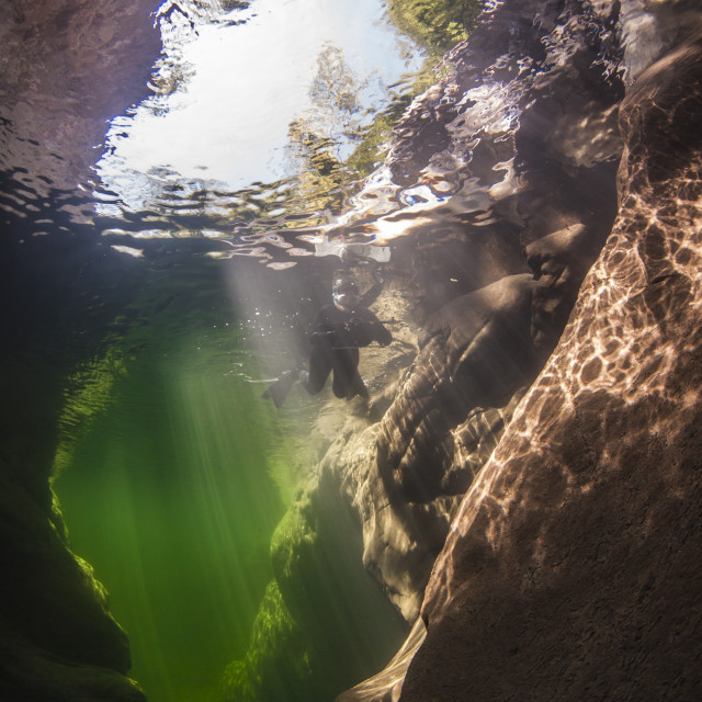 """""""Underwater scenery in river Maggia / Switzerland / Europe with snorkeler and magical sun beams"""" stock image"""