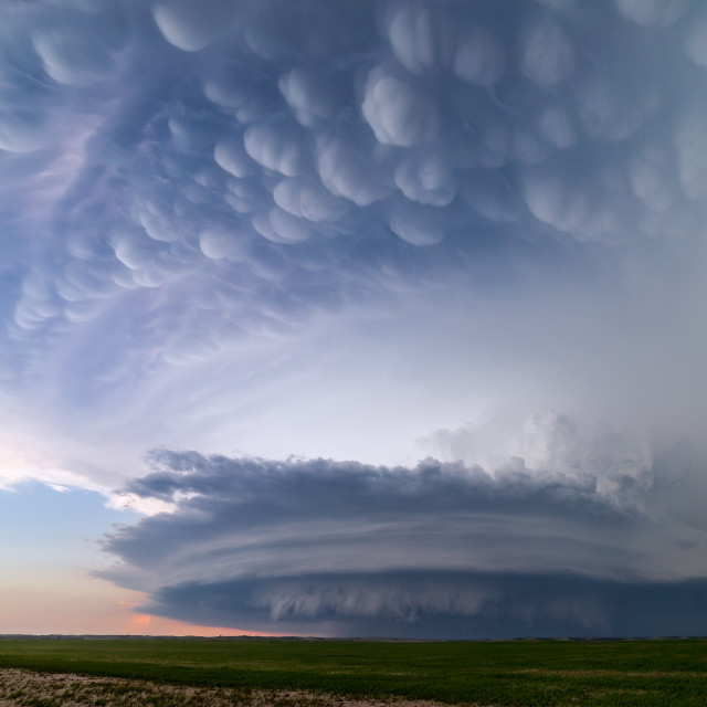 """Mammatus clouds erupt above a supercell thunderstorm"" stock image"