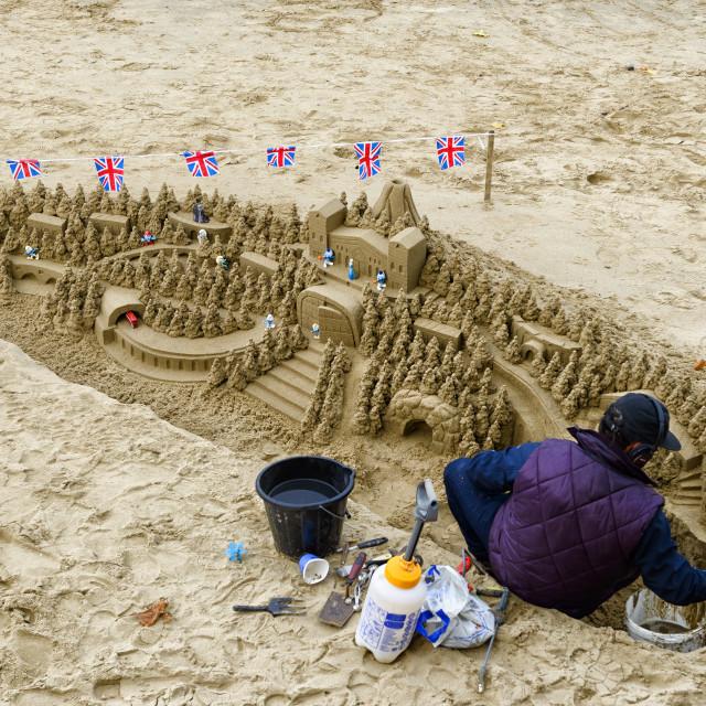 """Sand artist at work"" stock image"