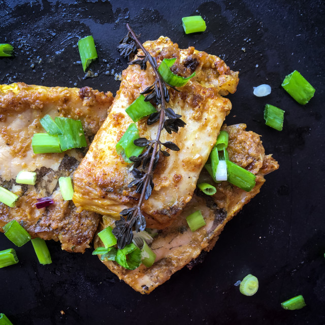 """Pan fried fish with Thyme and spring onions"" stock image"