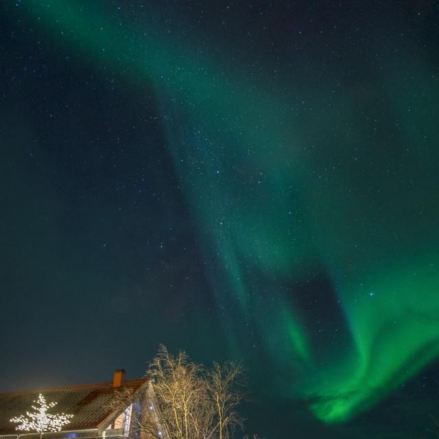 """Aurora Borealis dancing over Abisko National Park in Sweden"" stock image"