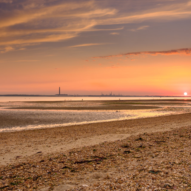 """Sunset over the sands of Solent"" stock image"