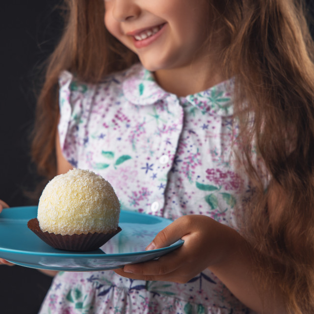 """Beautiful little girl surprised from a tasty big chocolate cocon"" stock image"