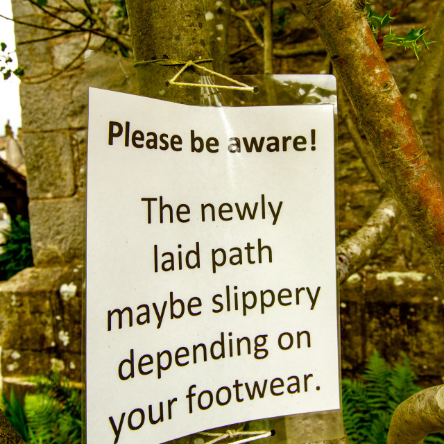 """Warning Sign, Slippy Path, St Mary's Church, Kettlewell, Yorkshire Dales."" stock image"