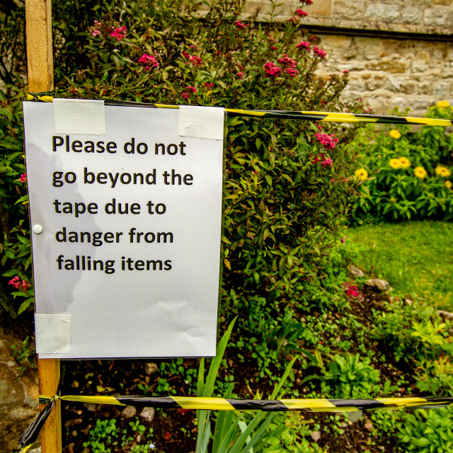 """Warning Sign, Falling Items, St Mary's Church, Kettlewell, Yorkshire Dales."" stock image"