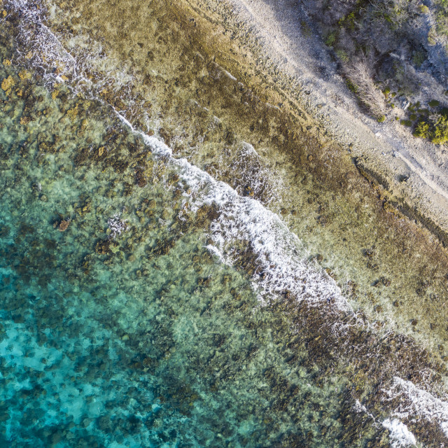 """""""Aerial view of coast of Curaçao in the Caribbean Sea with turquoise water, cliff, beach and beautiful coral reef"""" stock image"""