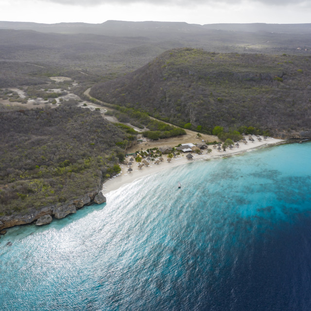 """""""Aerial view of coast of Curaçao in the Caribbean Sea with turquoise water, cliff, beach and beautiful coral reef around Cas Abao"""" stock image"""
