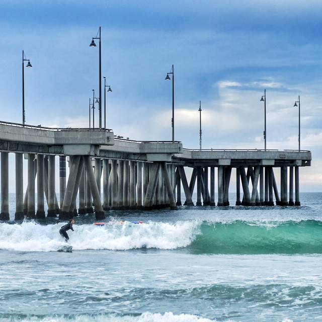 """Surf break Venice fishing pier"" stock image"