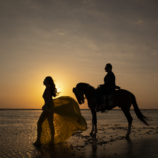 """Sunset beach couple"" stock image"