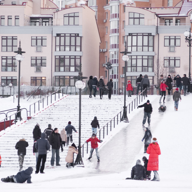 """Children Sliding Down Icy Slope in Obolon, Kyiv, Ukraine"" stock image"
