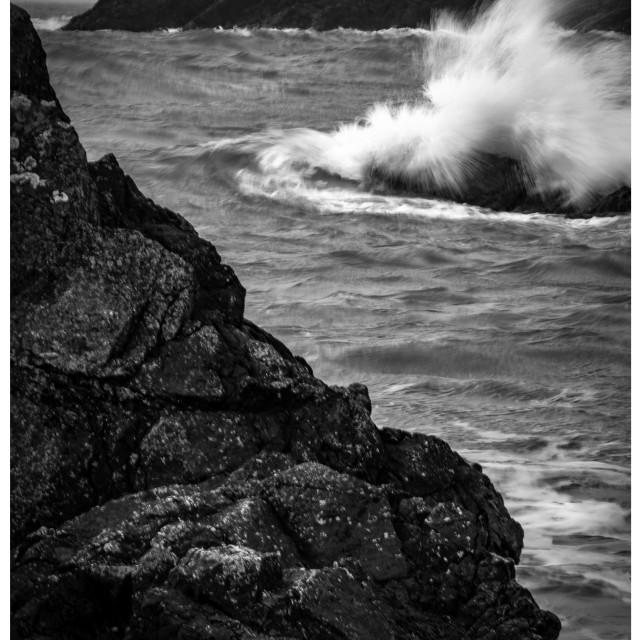 """Wave breaking over rock"" stock image"