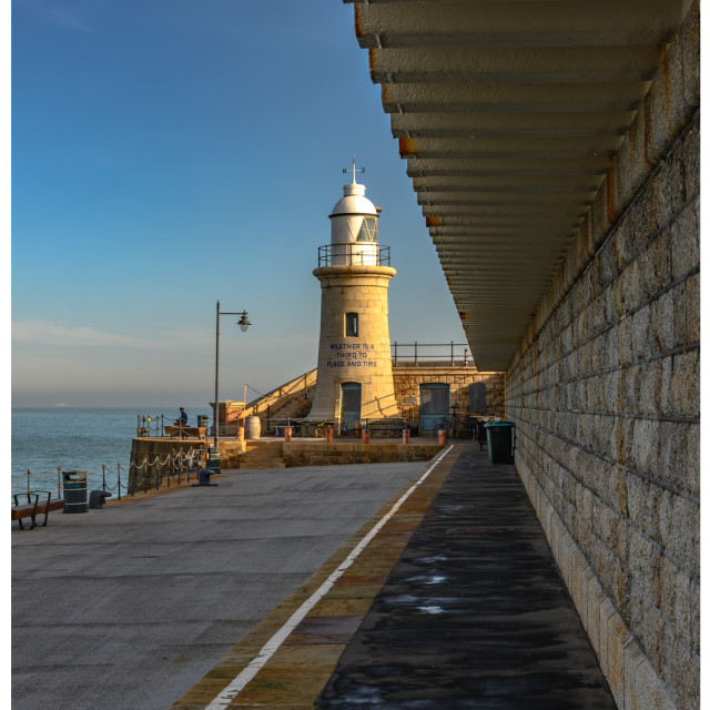 """Folkestone pier and lighthouse"" stock image"