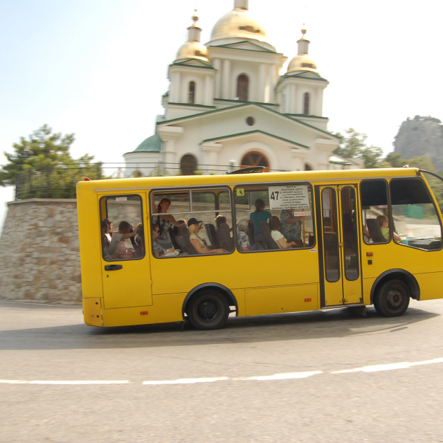 """Bus passing church on hill in Crimea, Ukraine"" stock image"