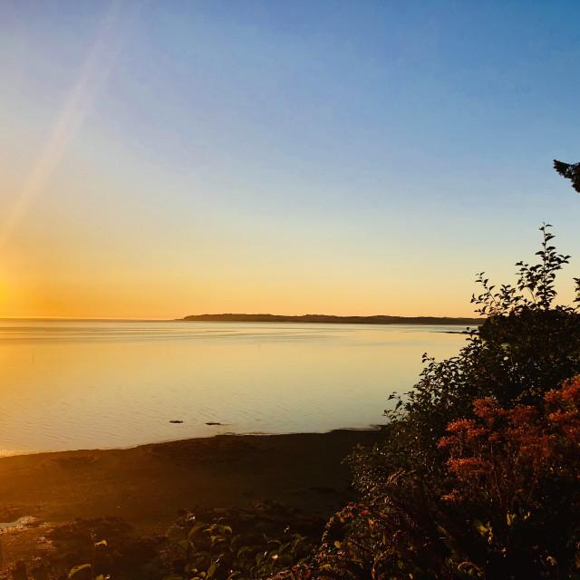 """""""Sun Sliding into Ocean"""" stock image"""