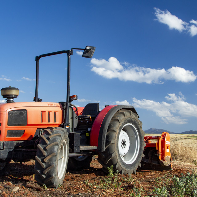 """Tractor Harvesting Wild Wheat"" stock image"