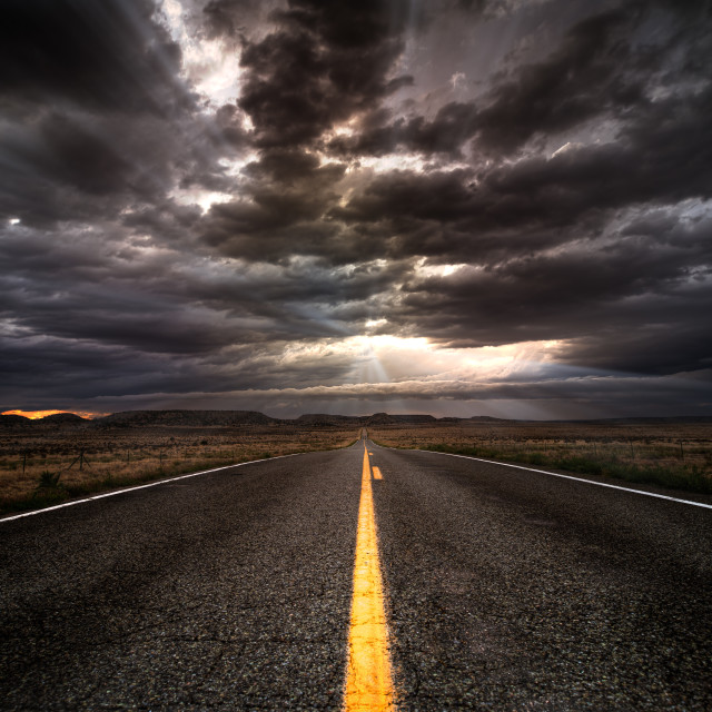 """Asphalt Road into the Sunset"" stock image"
