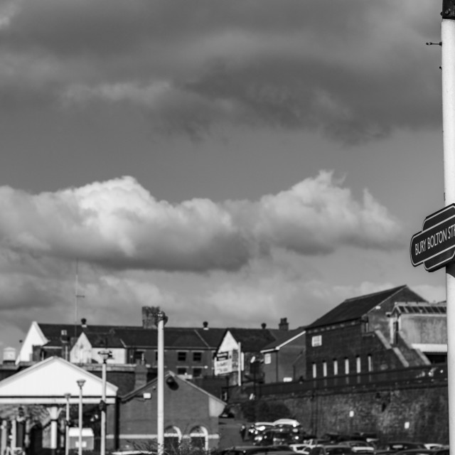 """The Bolton/Bury East Lancs Train Station Sign in Black & White"" stock image"