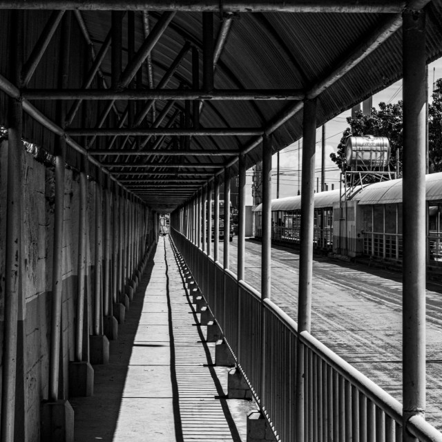 """Symmetrical Walkway At The Cebu City Port in Black & White"" stock image"