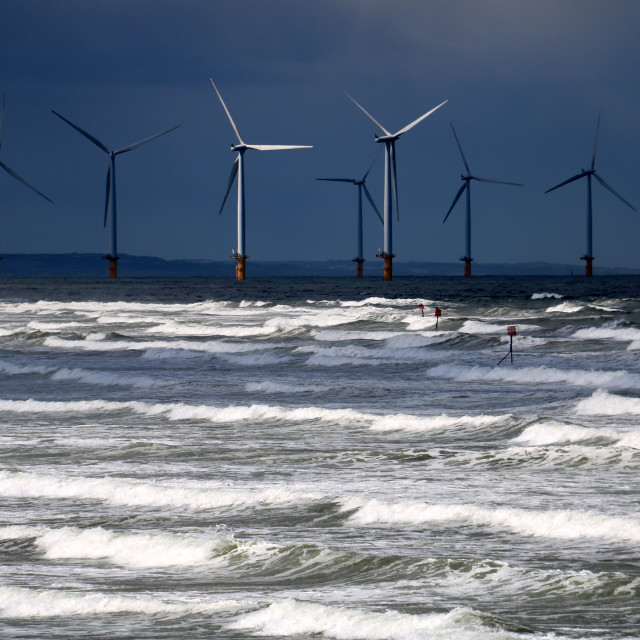 """Pre-storm light and rough sea at Redcar wind-farm."" stock image"