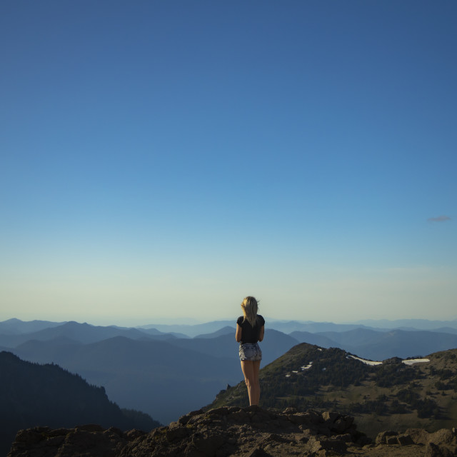 """""""Mount Rainier Girl Looking At Distant Mountains"""" stock image"""