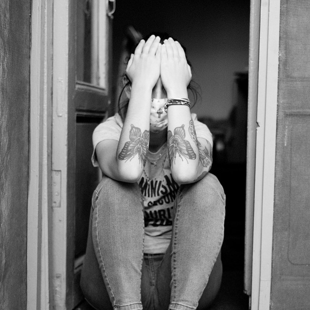 """""""The girl with tattoos who saw no evil"""" stock image"""