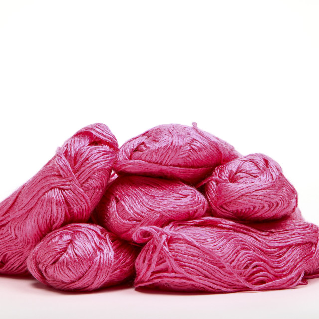 """""""Balls of pink knitting wool isolated on a white background"""" stock image"""