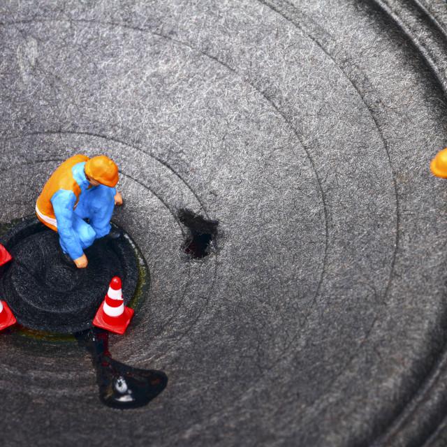 """Miniature figure workmen inspecting damage to a loudspeaker HI FI repair concept"" stock image"