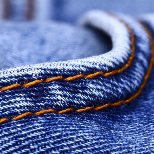 """Background of blue indigo denim jeans and stiching"" stock image"