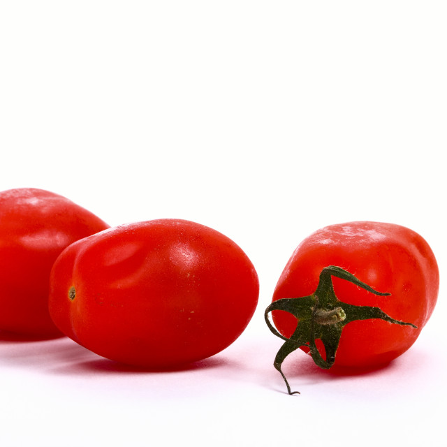 """""""Baby plum tomatoes isolated on a white background"""" stock image"""