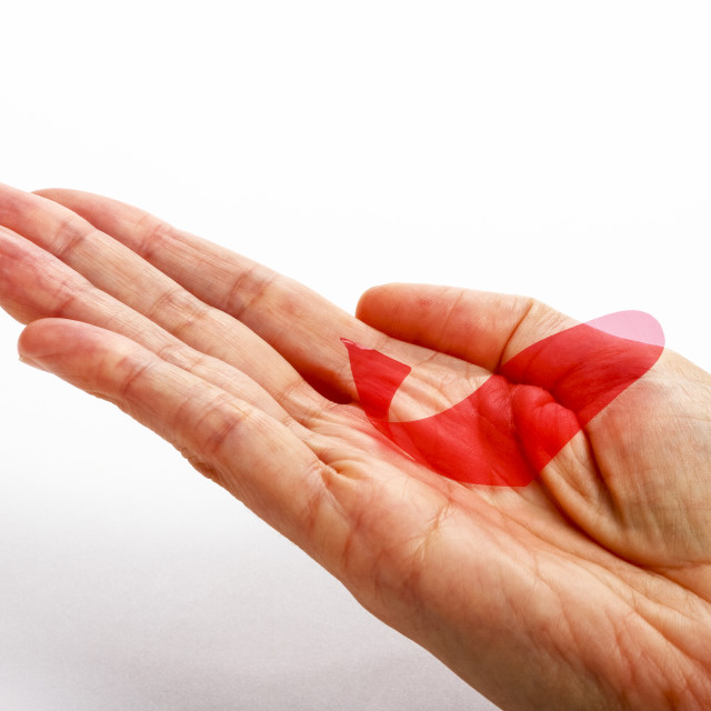 """""""Fickle fish fortune telling fish usually found in a christmas cracker in the palm of a womans hand"""" stock image"""