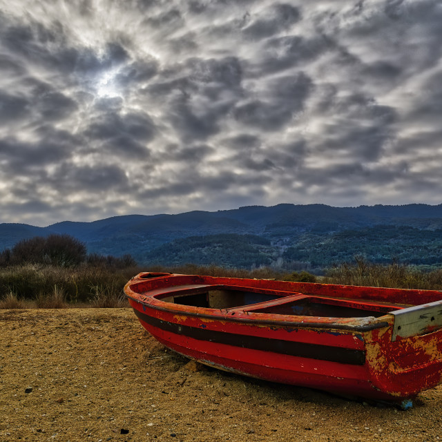 """A red boat on the beach at lake Koroneia, Greece"" stock image"