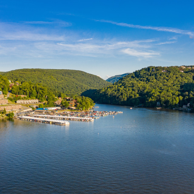 """""""Wide panorama of Cheat Lake on a summer evening with boats docked in marina"""" stock image"""
