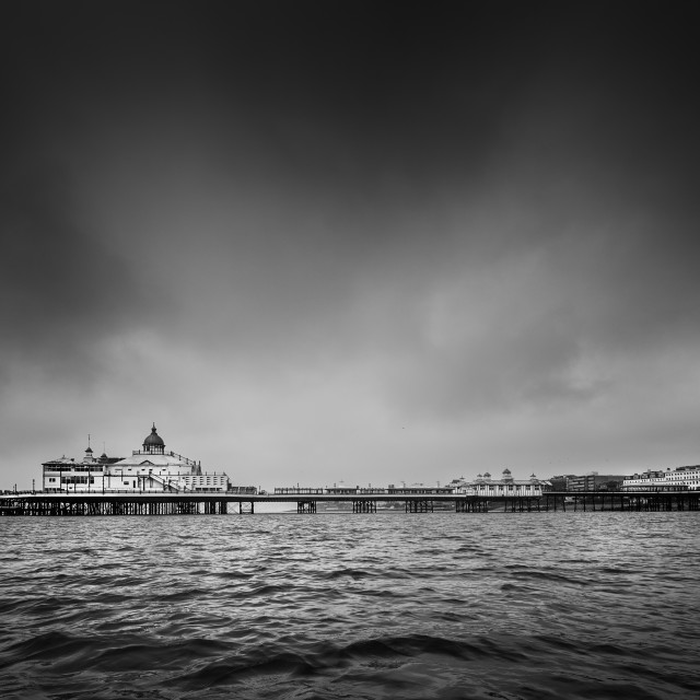 """Stormy day at Eastbourne Pier"" stock image"