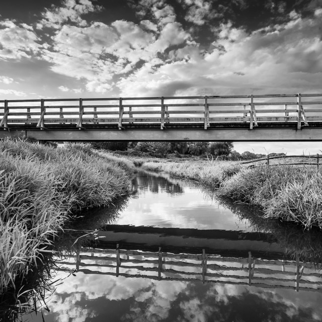 """The white bridge over Cuckmere river."" stock image"