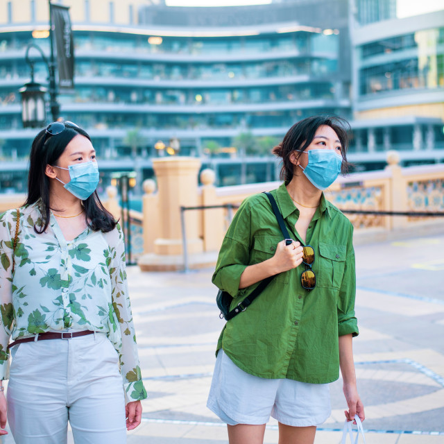 """""""Two female friends Asian woman wearing face mask in outdoors sho"""" stock image"""