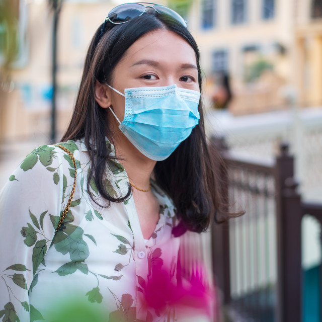 """""""Asian woman wearing face mask in outdoors shopping mall"""" stock image"""