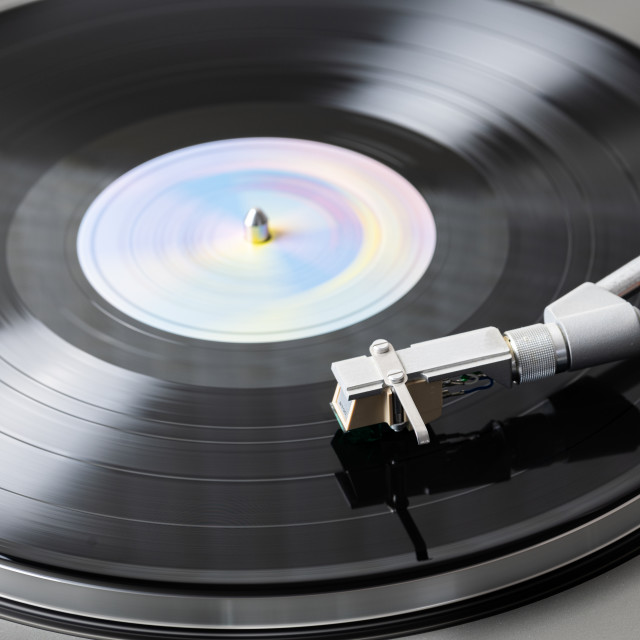 """""""Vinyl Record Playing on a Record Player"""" stock image"""