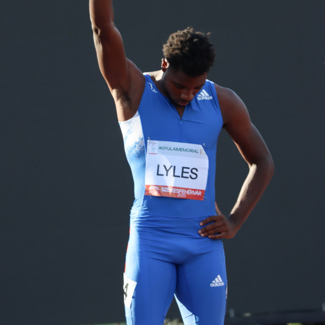 """""""Noah Lyles raising his fist at a competition in Hungary"""" stock image"""