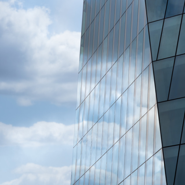 """""""Blue sky reflected in the exterior glass facade of a modern corp"""" stock image"""