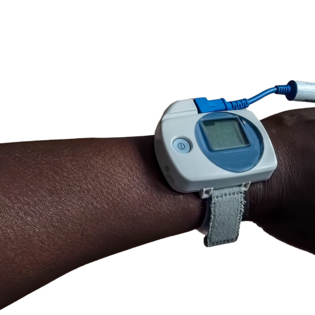 """""""Sleep pulse oximeter on the arm of a black man"""" stock image"""