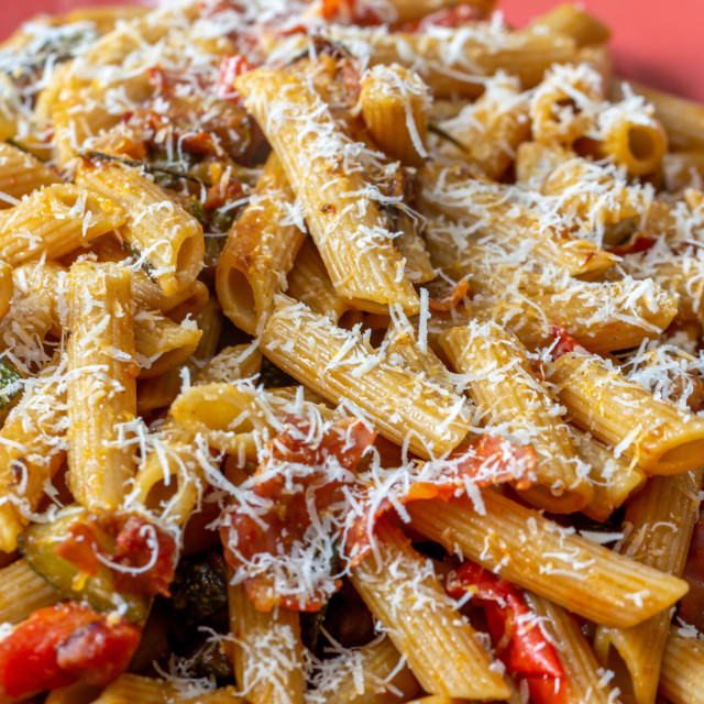 """""""Penne pasta with courgettes, bacon and tomatoes"""" stock image"""