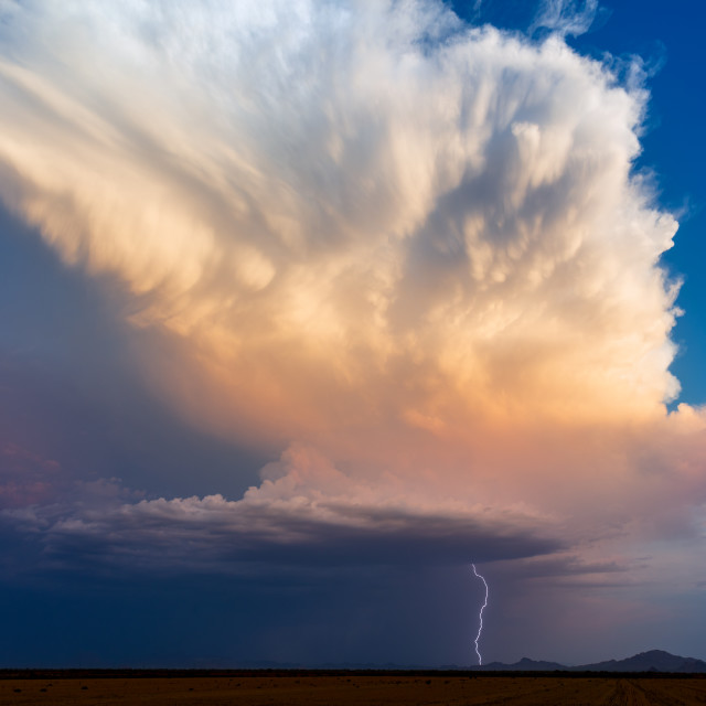 """Thunderstorm lightning strike at sunset"" stock image"