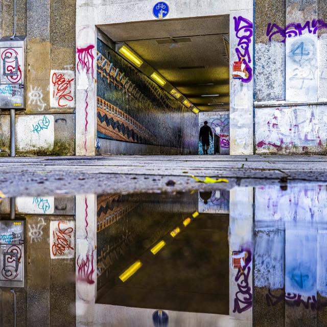 """Reflections from East Road Subway, Cambridge UK."" stock image"