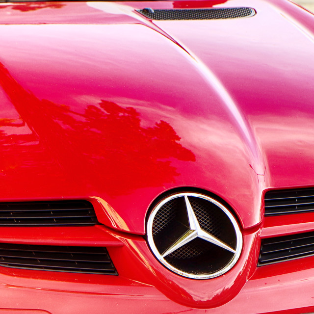 """""""Red Mercedes car hood front view"""" stock image"""