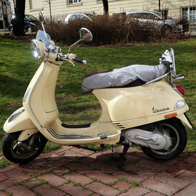 """""""Vintage yellow Vespa, lateral view"""" stock image"""