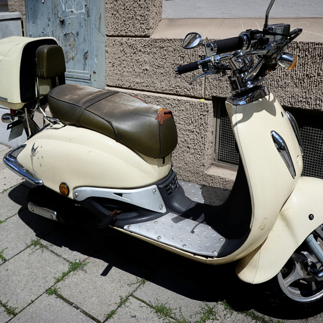 """""""Vintage Vespa painted of creamy white, lateral view"""" stock image"""