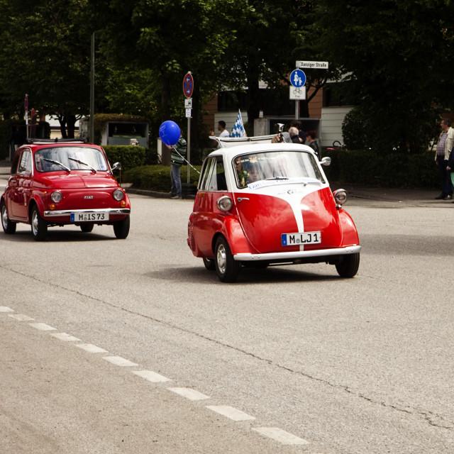 """Shiny red Fiat 500 Vintage car & BMW Isetta 300"" stock image"